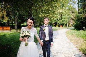 Gorgeous wedding couple holding hand