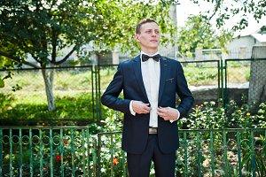 Portrait of a handsome groom posing