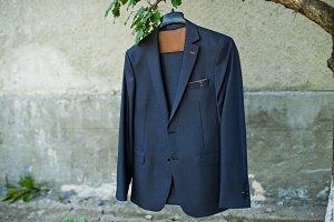 Close-up photo of groom's jacket han