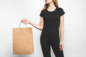 young woman in blank black t-shirt o