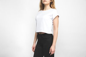 stylish woman in blank t-shirt on wh