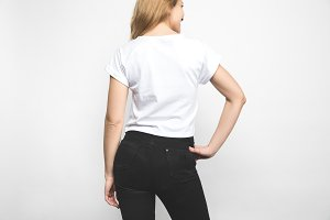 back view of young woman in blank t-