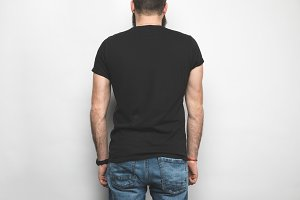 back view of man in black t-shirt is