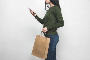 young woman in blank green sweatshir