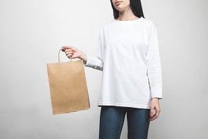 young woman in blank sweatshirt on w