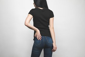 back view of young woman in blank bl