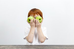 boy with green apples