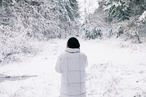 rear view of woman walking in snowy