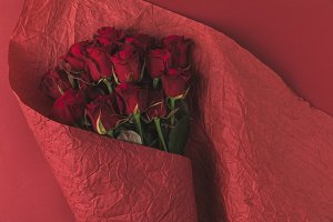 top view of bouquet of roses in wrap
