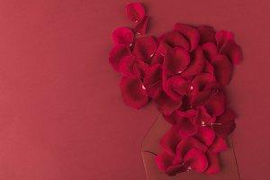 top view of roses petals and envelop
