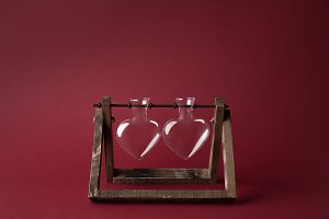 two empty heart shaped glass jars on