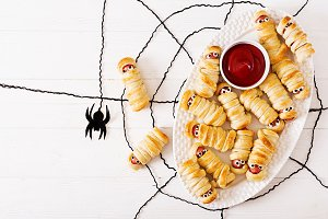Scary sausage mummies in dough