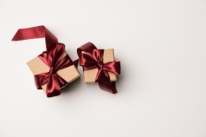 top view of gift boxes with red ribb