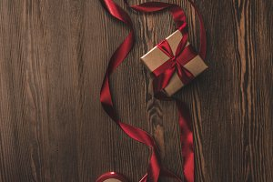 flat lay with present and red ribbon