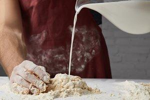 cropped image of chef preparing doug
