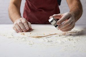 cropped image of chef preparing hear