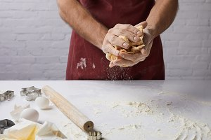 cropped image of chef kneading dough