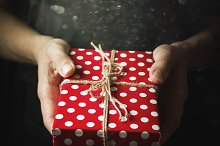Hands holding a small gift by  in Animals