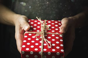 Hands holding a small gift