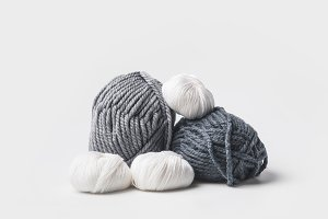 grey and white yarn balls isolated o