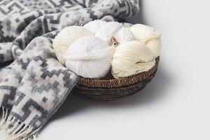 white yarn balls in wicker basket wi