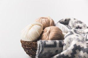 colored yarn balls in wicker basket
