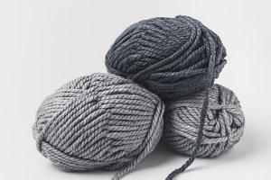 three grey yarn balls isolated on wh