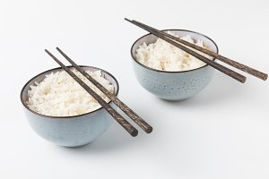 bowls of tasty rice with chopsticks