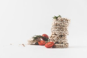 stack of rice cakes with rosemary an