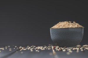 bowl of raw rice on black table with