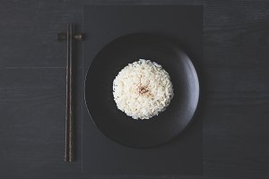 top view of tasty rice and chopstick