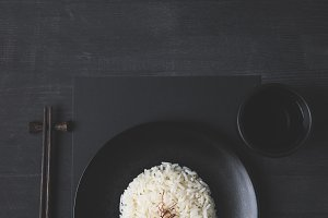 top view of rice on plate with cup o