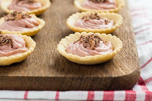 strawberry tartlet with raspberry cr