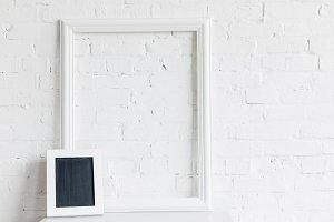 blank frame and small chalkboard in