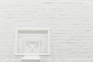 white brick wall with empty frame on