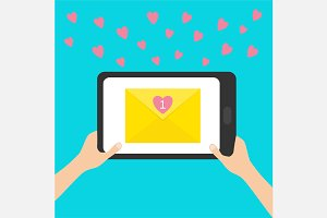 Two hands holding  tablet Email love