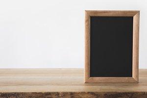 one empty blackboard on wooden table
