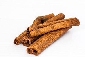 cinnamon sticks on a white backgroun