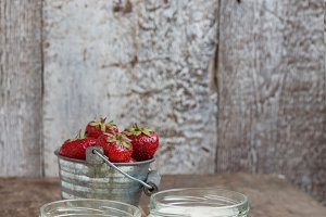 yoghurt in a glass and a bucket with
