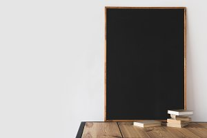 books and big blackboard on wooden t