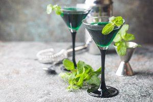 Green cocktails in martini glasses