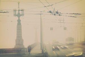 Fog in the city on the bridge