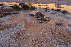 Sea frozen on a sandy beach