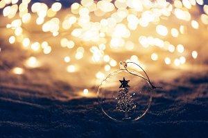 Christmas ornament on snowy illumina