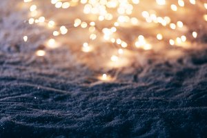 Snowy winter background with fairy l