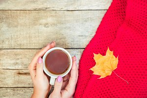 A cup of tea and a cozy autumn backg