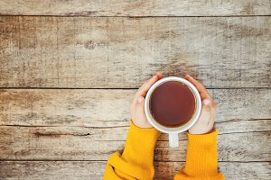 cup of tea in the hands of a child a