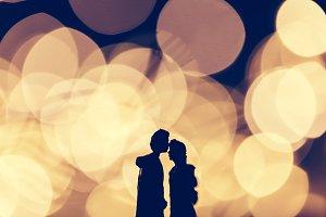 Romantic couple kissing on illuminat