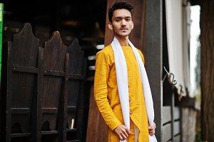 Indian stylish man in yellow traditi