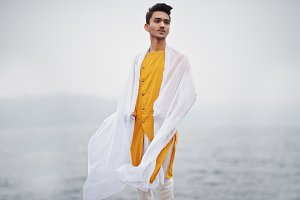 Indian stylish man in yellow traditi